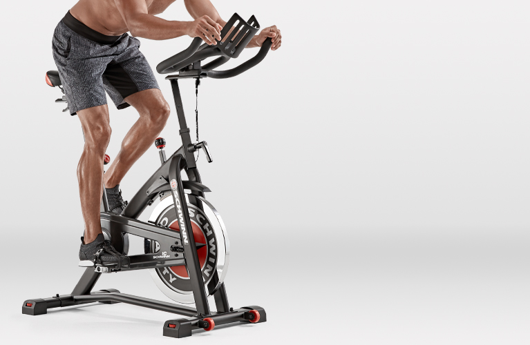 Man riding a Schwinn IC3 indoor cycling bike
