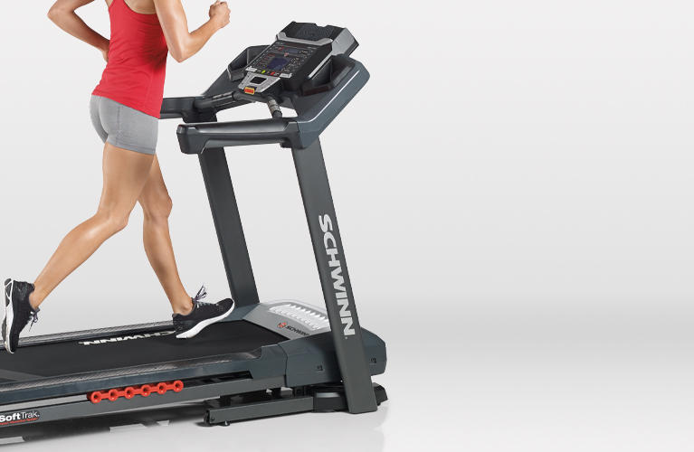 Woman running on a Schwinn treadmill