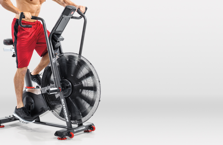 Man riding a Schwinn Airdyne exercise bike